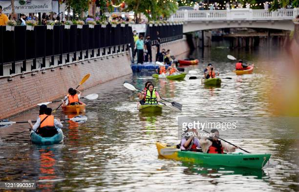 Visitors paddling on Ong Ang canal. The restored canal offers paddle kayaking in the heart of the city, it won a 2020 United Nations human...