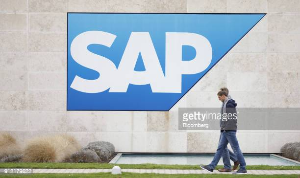 Visitors pass a SAP SE logo outside the businesssoftware maker's headquarters in Walldorf Germany Tuesday Jan 30 2018 SAP agreed to buy Callidus...