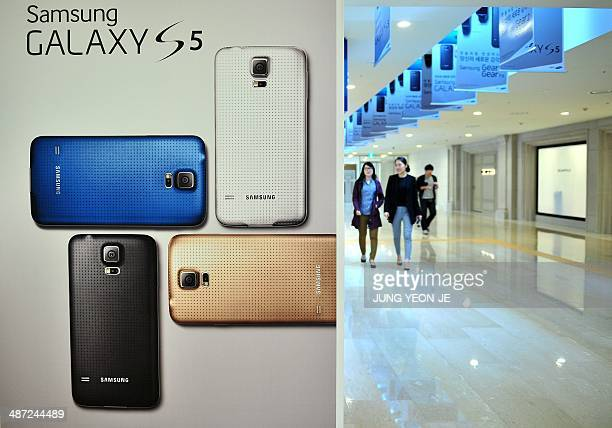 Visitors pass a signboard of Samsung Electronics' Galaxy S5 at its showroom in Seoul on April 29 2014 Samsung Electronics reported on April 29 its...
