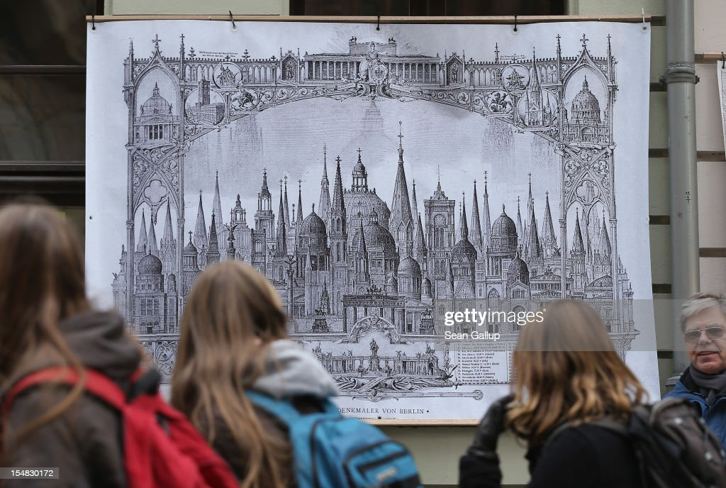 Visitors pass by a poster showing many of Berlin's historic, pre-war buildings crowded together during celebrations marking the 775th anniversary of the city of Berlin on October 27, 2012 in Berlin, Germany. Celebrations are continuing over the weekend and will culminate in a fire presentation by the French fire performers Carabosse on Sunday. The settlement of Coelln, which stood opposite Berlin on the Spree river, is first referred to in a document from 1237, and by the beginning of the 14th century Coelln and Berlin joined together to become the region's most important trading center.