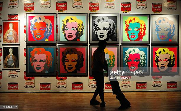 Visitors pass by Andy Warhol's screen print collection ''Marilyn Monroe'' at Andy Warhol's museum in eastern Slovak town of Medzilaborce on July 15...