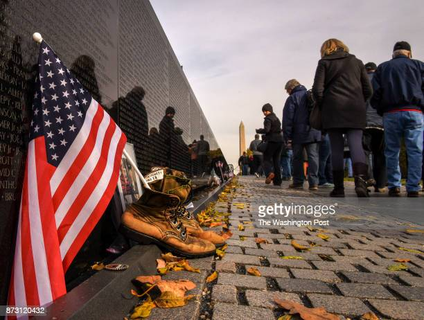 Visitors pass by mementos left in tribute after ceremonies to commemorate the 35th anniversary of the Vietnam Memorial on Veterans day on November...