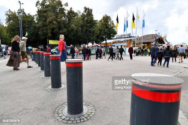 Visitors pass by security traffic bollards on their way to the the festival area at day 2 of the 2017 Oktoberfest beer festival on September 17 2017...