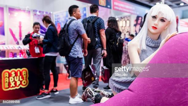 Visitors pass by the silicon made sex doll during the Asia Adult Expo 2017 at the Hong Kong Convention and Exhibition Centre on 29 August 2017 in...