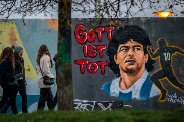 DEU: Football Fans In Germany Pay Their Respects To Diego Maradona