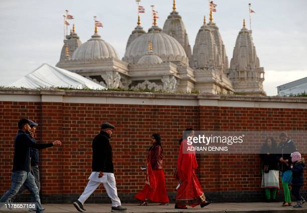 Visitors pass outside of the Swaminarayan Mandir temple in Neasden, north west London on October 28 as Diwali celebrations get underway. - Diwali,...
