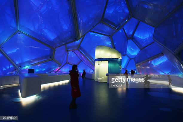 """Visitors pass the audience's rest area which is named """"Bubbles Bar"""" before the """"Good Luck Beijing"""" World Swimming China Open at the National Aquatics..."""