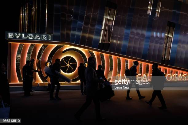 Visitors pass the Bulgari display stand at the BaselWorld watch fair on March 22 2018 in Basel Switzerland The annual watch trade fair sees the very...
