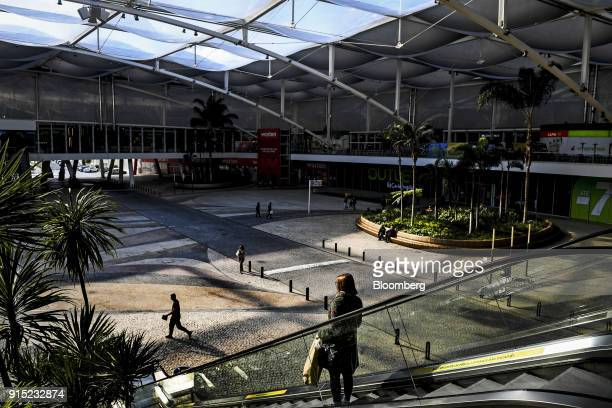 Visitors pass through a large courtyard at the Dolce Vita Tejo shopping mall operated by AXA Real Estate Investment Managers SGR SpA in Lisbon...