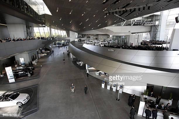 Visitors pass through the new BMW World customer center in Munich Germany on Wednesday Oct 17 2007 Bayerische Motoren Werke AG today celebrates the...