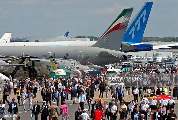 Visitors pass through the Paris Air Show in Le Bourget France Monday June 13 2005