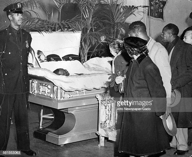 Visitors passing the open coffin of Bill Robinson Bojangles entertainer actor and dancer at his funeral, New York City, New York, March 12, 1949.