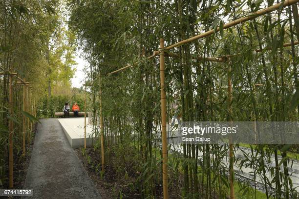 Visitors pause among bamboo trees in a Chinese garden at the IGA 2017 international garden exhibition on April 28 2017 in Berlin Germany The IGA...