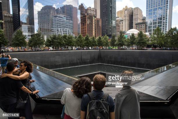 Visitors pause at the National September 11 Memorial September 8 2017 in New York City New York City is preparing to mark the 16th anniversary of the...