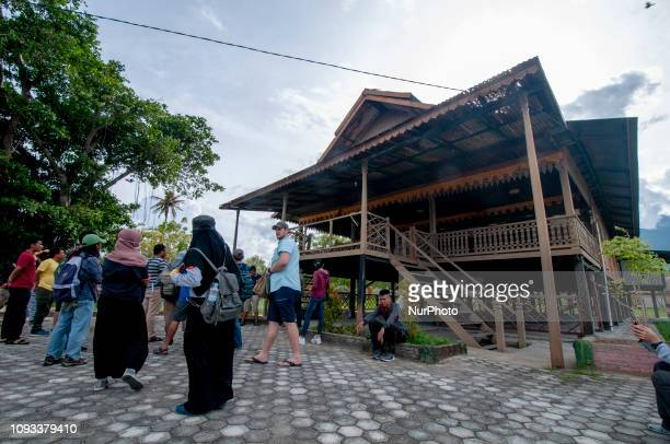Visitors pay attention to the building of Banua Oge or Souraja in Palu Central Sulawesi Indonesia Sunday 3 February 2019 The house that was built in...