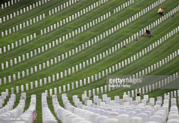 Visitors pay respects at graves inside Ft Rosecrans National Cemetery on May 25 2020 in San Diego California Due to the Covid19 pandemic Memorial Day...
