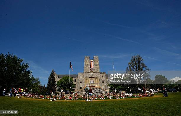 Visitors pay their respects at a memorial to the 32 students and faculty killed in the Virginia Tech shootings at the Drill Field of the school's...