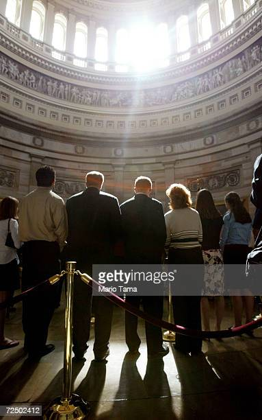 Visitors pay their respects at former President Ronald Reagan's casket inside the US Capitol June 10 2004 in Washington DC Reagan's body will lie in...