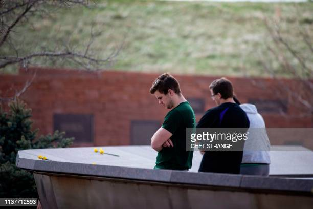 Visitors pay their respects at the Columbine shooting memorial near Columbine High School on Wednesday April 17 2019 in Littleton Colorado All...