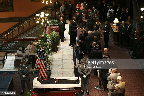 Visitors pay their respects during an open viewing for Rev Clementa Pinckney at the South Carolina State House June 24 2015 in Columbia South...