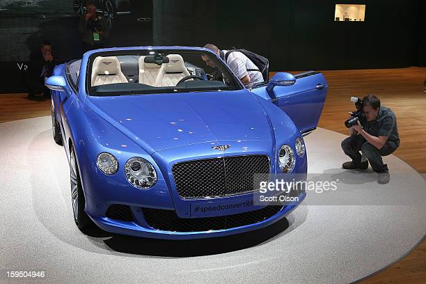 Visitors photograph a 202 MPH Bentley Continental GT Speed Convertible during the media preview at the North American International Auto Show on...