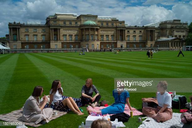 Visitors picnic on the lawn in the newly opened gardens at Buckingham Palace on July 08, 2021 in London, England. The gardens will be open from...