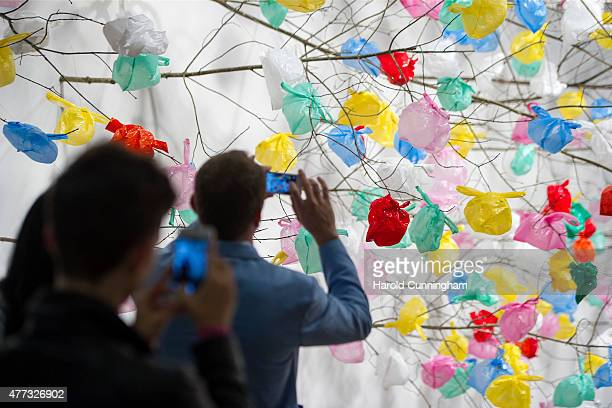 Visitors picture the artwork Plastic Tree by Pascale Marthine Tayou during Art Basel on June 16 2015 in Basel Switzerland Art Basel one of the most...