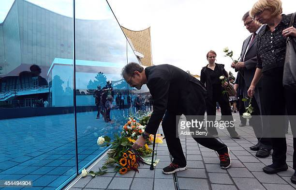 Visitors place flowers on a monument dedicated to the over 200000 victims of the euthanasia program used by Hitler's National Socialist government to...