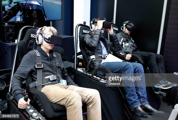 Visitors play a video game with Oculus Rift VR headsets to experience 3D virtual reality during the show 'Virtuality Paris 2017' on February 24 2017...