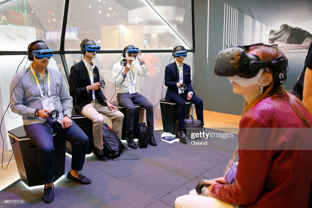 Visitors play a video game with the Acer Windows Mixed Reality Headset during the Viva Technologie show at Parc des Expositions Porte de Versailles on May 24, 2018 in Paris, France. Viva Technology, the new international event brings together 5,000 startups with top investors, companies to grow businesses and all players in the digital transformation who shape the future of the internet.