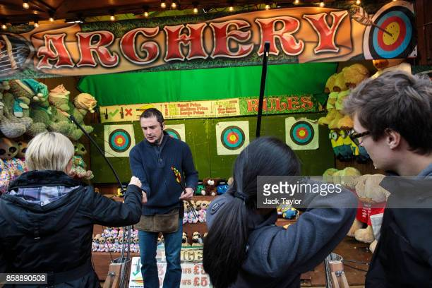 Visitors play an archery game at the Nottingham Goose Fair in the Forest Recreation Ground on October 7 2017 in Nottingham England The annual goose...