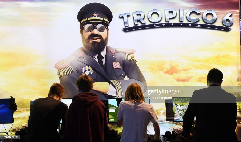 Visitors play computer games during gaming fair 'gamescom' in Cologne, western Germany on August 22, 2017. /
