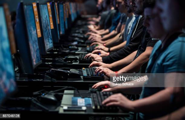 Visitors play on a computer while visiting the Gamescom 2017 video gaming trade fair on August 22 2017 in Cologne Germany Gamescom is the world's...