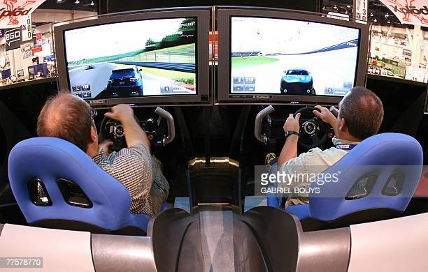 Visitors play on the new Gran Turismo 5 prologue car racing game on the Sony Playstation 3 at the SEMA show in Las Vegas Nevada 30 October 2007 The...