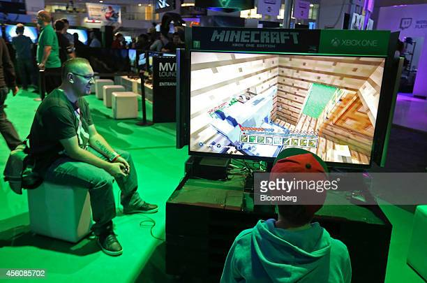Visitors play the Minecraft computer came produced by Mojang AB on Microsoft Corp Xbox One games consoles during the EGX gaming conference at Earls...