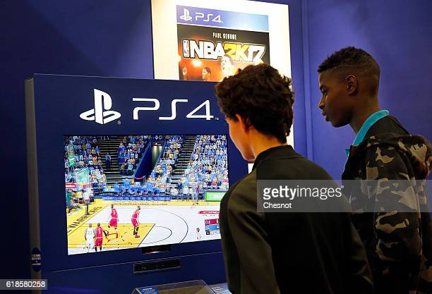 Visitors play the video game 'NBA 2K 17' developed byVisual Concepts and published by 2K Sports on Sony PlayStation game console PS4 during the...