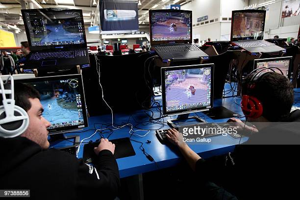 Visitors play World of WarCraft in the gaming hall at the CeBIT Technology Fair on March 3, 2010 in Hannover, Germany. CeBIT will be open to the...