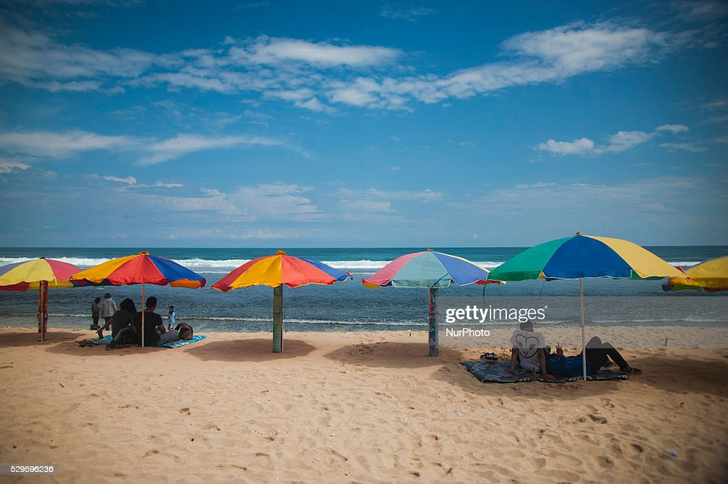 Visitors playing in Pok Tunggal Beach Gunung Kidul Yogyakarta Indonesia on May 7 & Beach Tourism In Indonesia Photos and Images | Getty Images