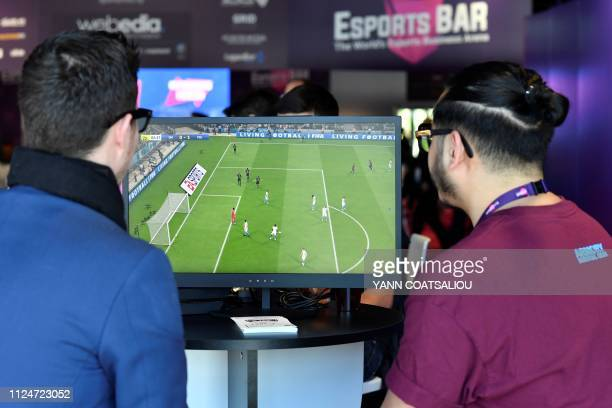 Visitors plays on EA Vancouver video game developer's football simulation video game FIFA 19 at the eSports Bar trade fair in Cannes southern France...