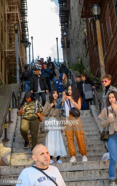 """Visitors pose and take selfies on the staircase in the Bronx, made famous by the movie """"Joker,"""" October 23, 2019 in New York. - In the Bronx borough..."""