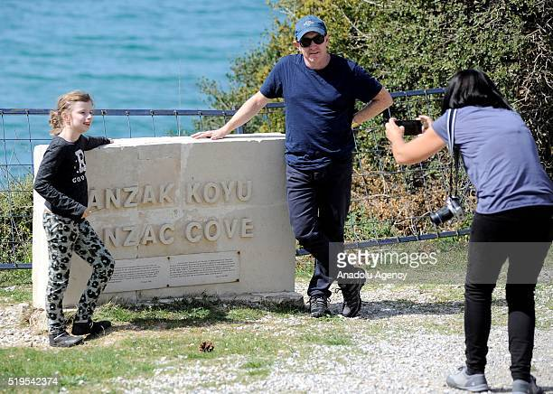 Visitors pose for a picture as they visit the cemeteries at Anzac Cove in Canakkale, Turkey on April 07, 2016 before the commemoration ceremonies of...