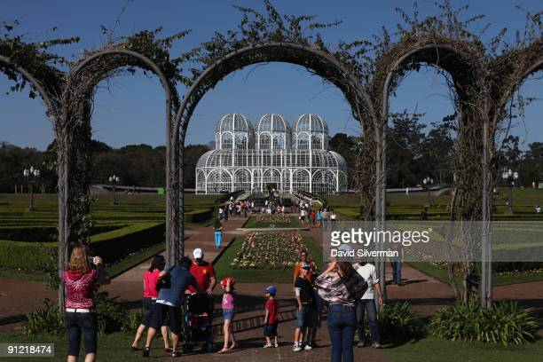 Visitors pose for photographs in the Botanical Garden on August 15 2009 in Curitiba the capital city of the state of Parana Brazil Curitiba...