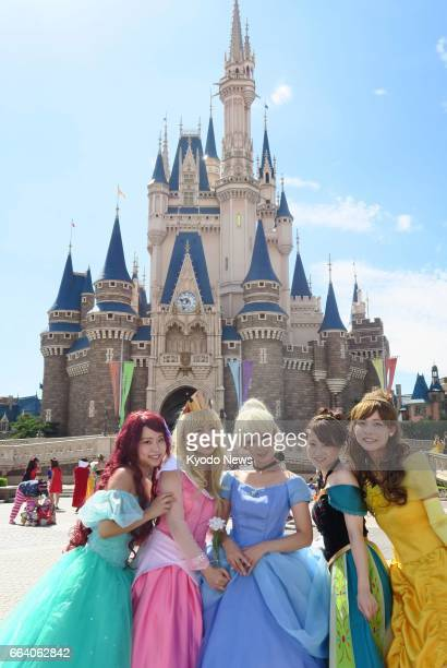 Visitors pose in Halloween costumes at Tokyo Disneyland in Urayasu Chiba Prefecture in this file photo taken in September 2016 The combined number of...
