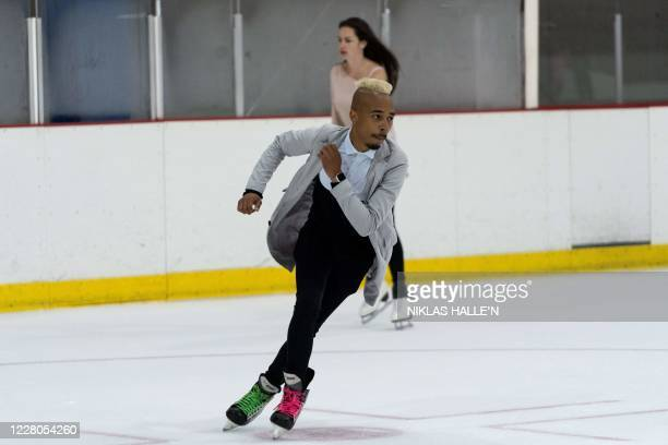 Visitors practice skating on the ice rink at Streatham Ice and Leisure Centre in Streatham, south London on August 15 as further easing of novel...