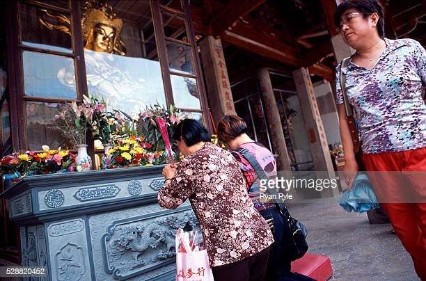 Visitors pray in front of the Hall of Heavenly King at the Nanputuo Temple in Xiamen. The Nanputuo Temple is located on the southeast of Xiamen...