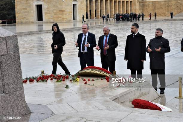 Visitors pray in front of the tomb of Ismet Inonu modern Turkey's second president and successor to Mustafa Kemal Ataturk at Anitkabir on the 45th...