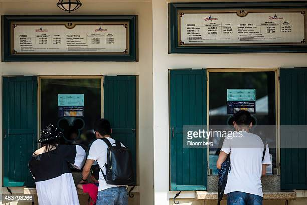 Visitors purchase tickets at a ticketing booth at Walt Disney Co's Disneyland Resort in Hong Kong China on Friday Aug 7 2015 Hong Kong is scheduled...