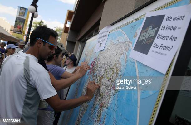 Visitors put pins on map to show where they are from during the Wyoming Eclipse Festival on August 20 2017 in Casper Wyoming Thouands of people have...
