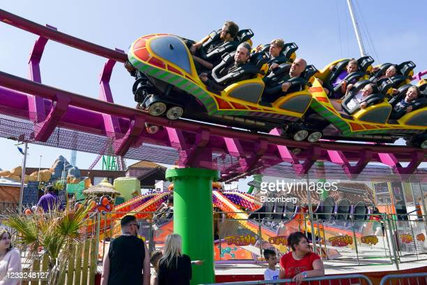 Visitors queue as a rollercoaster passes overhead at the Fantasy Island theme park in Skegness, U.K., on Monday, May 31, 2021 .U.K. Health...
