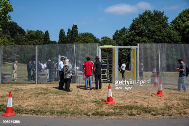 Visitors queue before entering through security fencing around Winfield House the London residence of US ambassador Woody Johnson ahead of President...